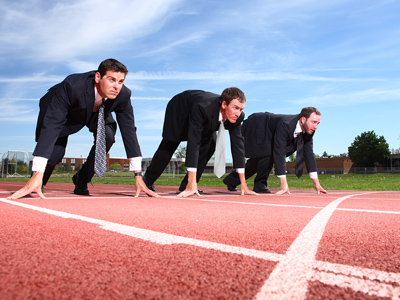 Business people lined up for race