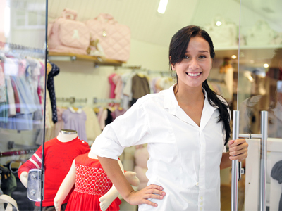 Small Business Owner: Proud Woman Opening Her Children Clothing