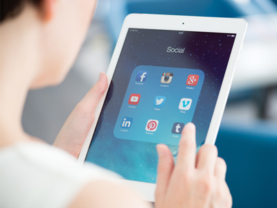 http://www.dreamstime.com/royalty-free-stock-photo-social-media-apps-apple-ipad-kiev-ukraine-may-woman-looking-applications-modern-white-air-which-designed-developed-image41023795