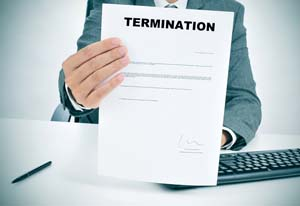 a man in suit in his desk showing a figured signed termination d