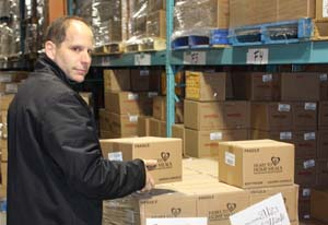 Michael Gazer, president of Heart to Home Meals, prepares food packages to be sent to Fort McMurrray. Photo courtesy Heart to Home Meals