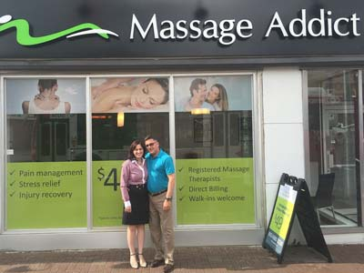Lucille Perrault and Larry Poirier in front of their new Massage Addict clinic at 1329 Wellington St. W in the Ottawa Westboro community. (CNW Group/Massage Addict)