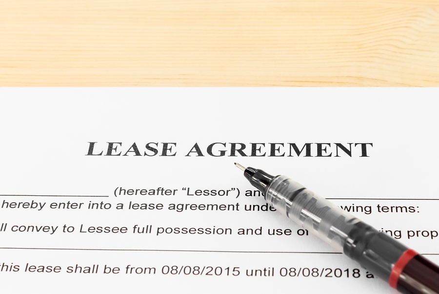 Lease Agreement Contract Document and Pen Horizontal View on Wood Table. Legal document for business event
