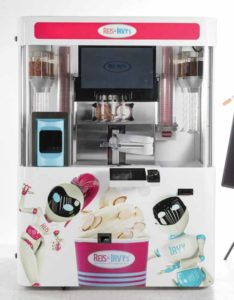 Customers select the toppings for their frozen yogurt. Photo courtesy Froyo Vending Canada
