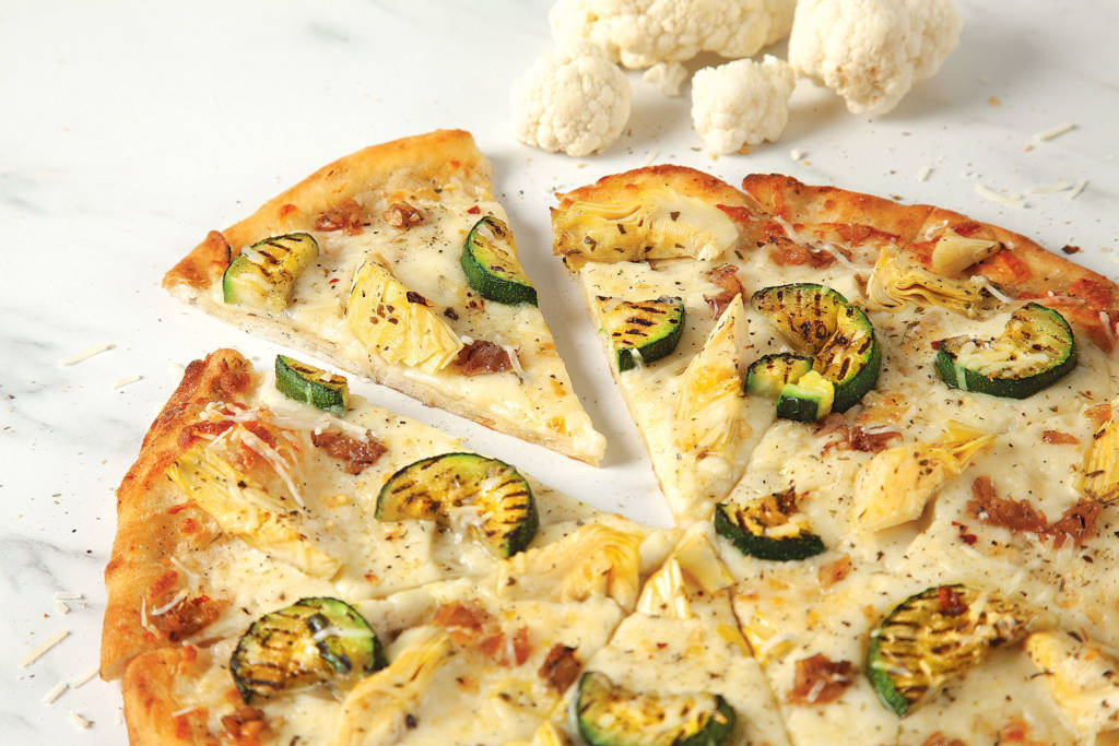 Pizza Pizza's new cauliflower crust has two servings of vegetables in every medium-sized pie and is also a source of fibre and iron.