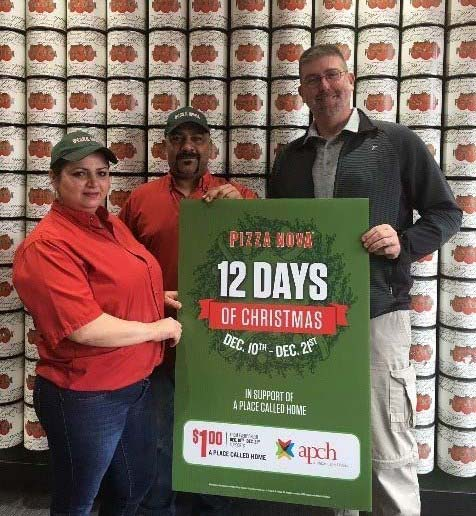"""Pizza Nova Lindsay franchisees Zlata and Khusrau """"Sam"""" Neikayen and David Tilley from A Place Called Home kick off the fundraising event."""