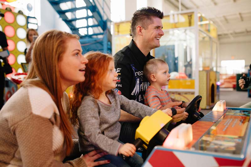 The Free family, Ronald McDonald House Charity alumni, enjoy a 'race' with Bryce Kenny.